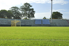 Goal and Green grass soccer field. In morning Stock Image