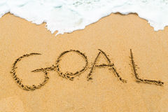 GOAL inscription written on sandy beach with wave approaching Royalty Free Stock Photos