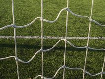 Goal keeper area. White stripe on artificial green soccer field. On outdoor stadium royalty free stock images