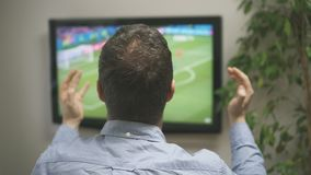 Goal!. Man watching football match on television at home stock video footage