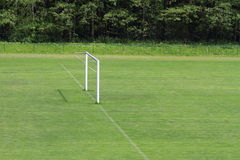 Goal without net. Training football field with natural grass and goal without net Stock Photo