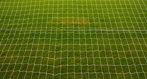 Goal net background. With grass football pitch or soccer field in america Royalty Free Stock Images