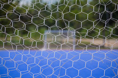 Goal net with blurred of futsal court Stock Photo