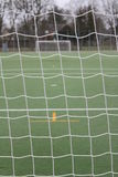 Goal net with football ground Stock Photo