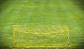 Goal net on green field Stock Photo
