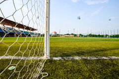 Goal net and white line in a soccer field. Detail of a goal net and white line in a soccer field Stock Photo