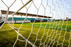 Goal net and white line in a soccer field. Detail of a goal net and white line in a soccer field Stock Images