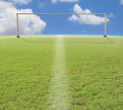 Goal o football on green grass blue sky Stock Photography