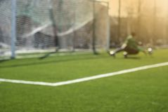Blurred football background: goalkeeper catches the ball during game moment. Goal outdoors spring sport goalkeeper goalie activity athlete competitive sport stock photography