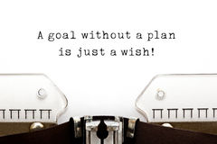 A Goal Without A Plan Is Just A Wish. ! quote printed on an old typewriter stock photography
