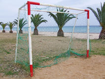 GOAL POST. Soccer goal post on a beach with palm trees Stock Photo