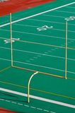 Goal Post. With Bright Green Clean turf in the background to the 30 yard line Stock Photos