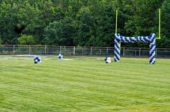 Goal Post and Balloons. A High School football field with goal posts decorated with balloons. The field decorations are preparations for a graduation ceremony Royalty Free Stock Images