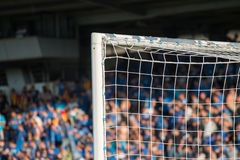 Goal post with soccer fans Royalty Free Stock Image
