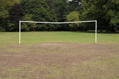 Goal posts. An empty netless soccer goal in a park Royalty Free Stock Images
