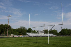 Goal Posts. And stands on football field in rural town royalty free stock photos