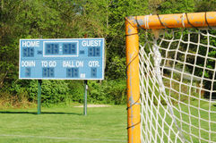 Goal and scoreboard. A goal and scoreboard on a small town field Stock Photography