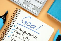 Goal setting concept. Notepad with pen on desk. Goal setting concept. Notepad with pen on the desk royalty free stock images