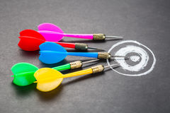 Goal Setting. Many darts aim on chalk drawing target, goal setting, competition or trend concept stock photography