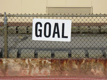 Goal Sign. On a cyclone fence stablized by cinderblock royalty free stock image