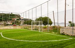 Goal at a small local football field in a Greek vi. Small local football field with a goal and artificial turf in a Greek village Royalty Free Stock Photos