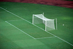 Goal soccer field. Goal area in soccer empty field by night Stock Photography