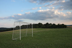 Goal on soccer field in village meadow. At sunny day Stock Photo