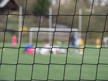 Goal a soccer net with green grass field. Detail of bound strings Stock Images