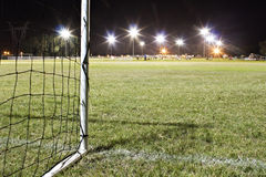 Goal on soccerfield at night Stock Photography