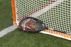 Goal and Stick. A lacrosse goal and the goalie's stick royalty free stock photography