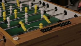 The goal table soccer. Two men playing table football yellow and white players foosball stock video footage