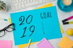 2019 goal text on colorful paper memo note with business office. Accessories. Top view from above stock photos