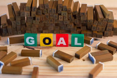 Goal text with wood stamper goal concept. Goal text with wood stampers goal concept royalty free stock photography