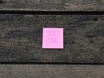 2017 Goal Word Written on Pink Sticky Note on Wooden Background. Great For Any Use Vector Illustration