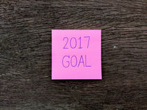 2017 Goal Word Written on Pink Sticky Note on Wooden Background. Great For Any Use Royalty Free Illustration