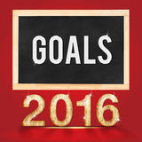 Goal for 2016 year on blackboard on red studio room background.  Stock Illustration