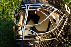 A goalie black helmet made from carbon material royalty free stock photos