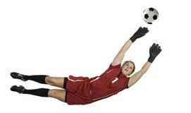 Goalie do futebol que salta para a esfera foto de stock