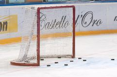 Goalie gate and hockey pucks Stock Photos