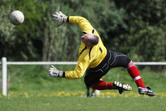 Goalie Goal Keeper. Pontypridd Town AFC goalkeeper dives in to save the ball during their Welsh Football League 2 match at Ynysangharad Park, Pontypridd, Wales royalty free stock images