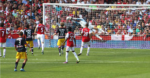 Goalie makes save for Arsenal Stock Images