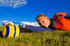Goalie and soccer ball. Teen plays soccer outside on grass Royalty Free Stock Images