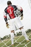 Goalkeeper With The Ball On The Field Royalty Free Stock Photo