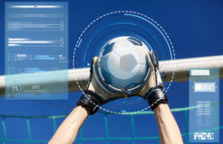 Goalkeeper with ball at football goal over sky Royalty Free Stock Images