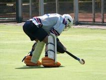 Goalkeeper bent over. Field hockey goalkeeper bent over Stock Images