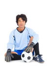 Goalkeeper in blue holding ball. On white background stock photography