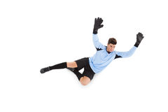 Goalkeeper in blue making a save. On white background stock photo