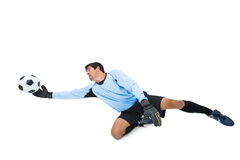 Goalkeeper in blue making a save. On white background stock images