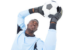 Goalkeeper in blue making a save. On white background royalty free stock image