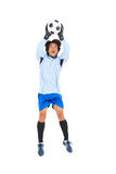 Goalkeeper in blue saving ball Royalty Free Stock Photography